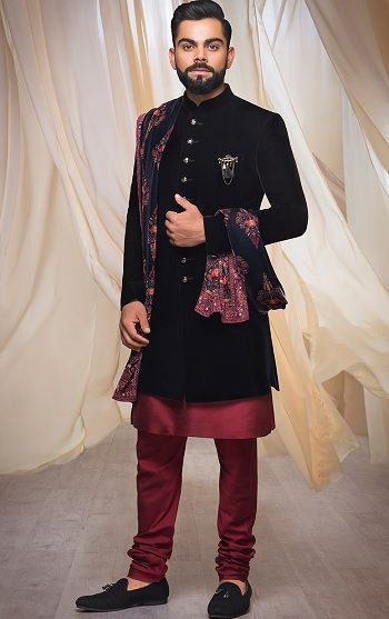 Buy Luxurious Plush Indo-Western Attire from the Virat Collection. Grab the latest range of Indian Ethnic & Wedding wear online by Manyavar. Wedding Outfit Mens, Indian Wedding Suits Men, Sherwani For Men Wedding, Wedding Outfits For Groom, Groom Wedding Dress, Sherwani Groom, Western Wedding Dresses, Indian Wedding Outfits, Best Wedding Dresses