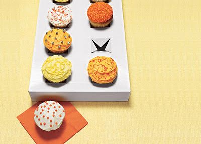 Make an instant cupcake carrier by cutting crosses into a box lid.