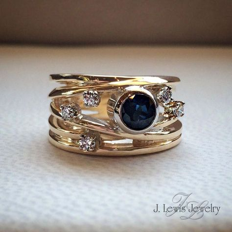Stunning customized J. Lewis Jewelry ring. This beautiful sapphire ring has one round blue sapphire