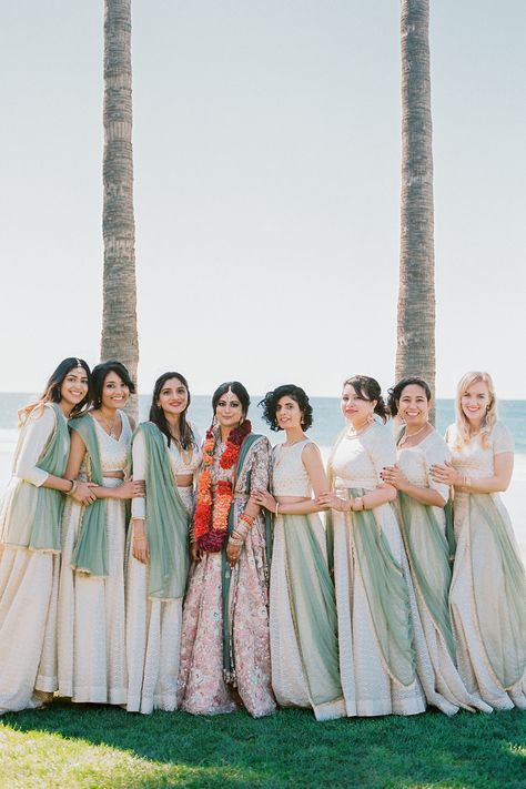 From the editorial A Colorful San Diego Wedding Day With Jaw-Dropping Ocean Views. This bride and her squad looked absolutely stunning at this beachside ceremony! Head to SMP to see how the rest of their celebration unfolded! Photography: @arielminphoto #bridesmaids #lehengas #bridesmaiddresses #indianwedding #sari #beachwedding