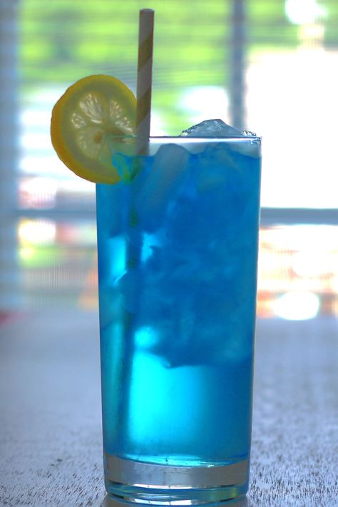 The Sex in the Driveway cocktail recipe is a blue variation on Sex on the Beach. The difference is the stunning blue color and no cranberry juice. It's a delicious blend of peach, orange and lemon-lime.