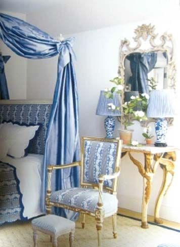French canopy bed, blue and white porcelain lamps with pale blue shades, gilt accents - Carolyne Roehm