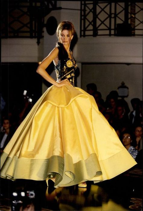 Stephanie Seymour in yellow angled pumps and a matching gown for the Versace 1992 couture collection.