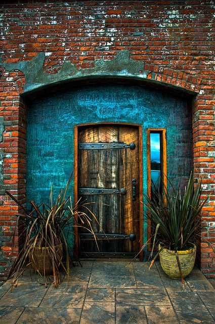 Old Cannery Door in Port Townsend, Washington - So in love with rustic doors and brick. The pop of color is perfection.