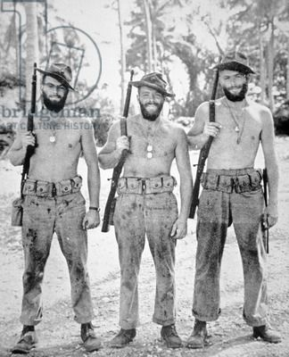Three brothers of the US Marine Corps in the South Pacific, 1943 (b/w photo)