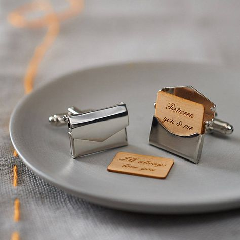 These cufflinks feature a smooth envelope that opens with a removable wooden letter inside which can be personalised with your own message. £45.00