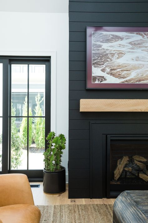 2019 Parade of Homes Walkthrough We are obsessed with the black shiplap surrounding the fireplace! It gives the living room such a modern look. Home Fireplace, Parade Of Homes, Fireplace Design, Family Room, Living Room With Fireplace, Shiplap Fireplace, Diy Fireplace Makeover, Black Fireplace, Fireplace Surrounds