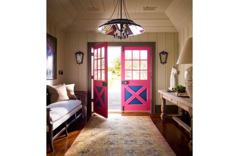 A pop of pink and blue in this barn house