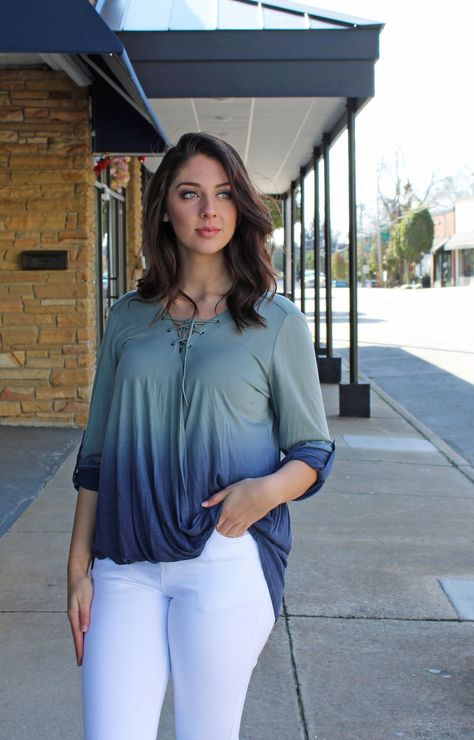This All Play No Work Ombre Top in blue is the perfect ombre top to complete your wardrobe! We love the roll-up sleeve and the lace up neckline detailing on this surplice top. Pair it with your favorite pair of skinnies, or leggings to complete the look. - Fit is true to size. - Relaxed fit with moderate stretch. - Unlined. - 70% Cotton 30% Rayon. - Hand wash cold/Hang to dry. - Model is 5'7, size 4/6 and shown wearing a size small.
