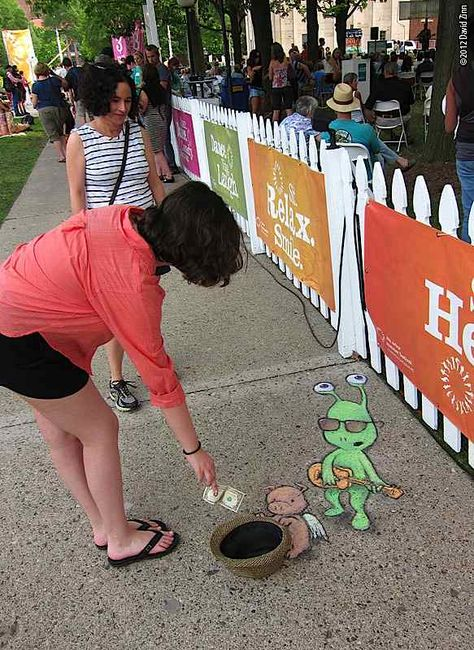 This artist, David Zinn does some absolutely surreal chalk art. Check out his pieces...