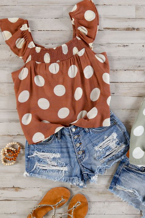 This smocked top is complete with ruffled sleeves and a large scale polka dot top. Pair with your favorite jeans for a grounded and stylish look. 62% Rayon, 38% Polyester Hand wash cold, do not bleach, lay flat to dry Measures 21 from shoulder to hem on size small Size small is pictured Imported #disneywear #disneyoutfits #polkadotsfashion #summeroutfits2021 #topsforwomencasual #inspostyle #styleinspiration #ruffleblousedesigns