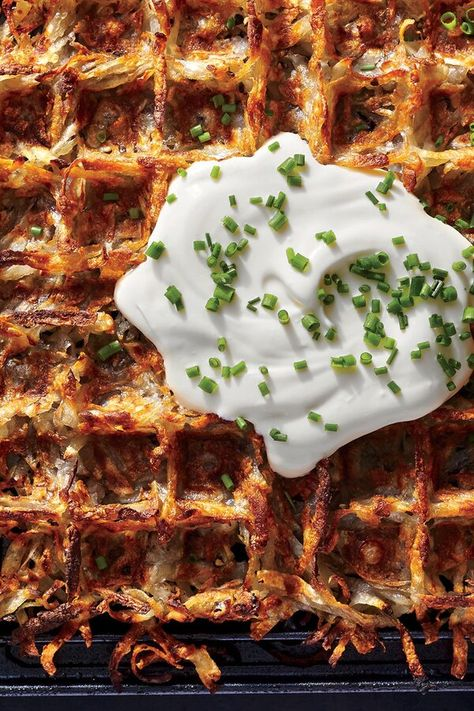 """The World's Crispiest Hash Browns   """"For hash browns that are crisp on the outside and buttery on the inside, look no further than your multifaceted waffle iron. These iconic breakfast spuds are similar to latkes, but we've streamlined the process to make them fail-proof. Try a dollop of Greek yogurt and a sprinkle of chives on top."""" #breakfastrecipes #brunchrecipes #breakfastideas #brunchideas #waffles #wafflerecipes #bestwafflerecipe #hashbrowns"""