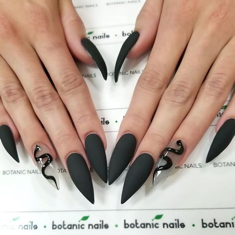 Matte Black Stiletto Nails   ❤️ Black stiletto nails are what you are missing while creating your bold and daring look. So, use these ideas as your best armor and you will not regret! ❤️ See more: https://naildesignsjournal.com/black-stiletto-nails-combinations/ #nailart #nailsdesigns #naildesignsjournal #easynaildesigns #blacknails #stilettonails