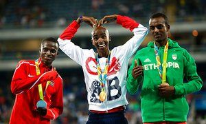 #Rio2016 Mo Farah celebrates on the podium with second placed Paul Kipngetich Tanui (left) of Kenya and third-placed Tamirat Tola of Ethiopia.