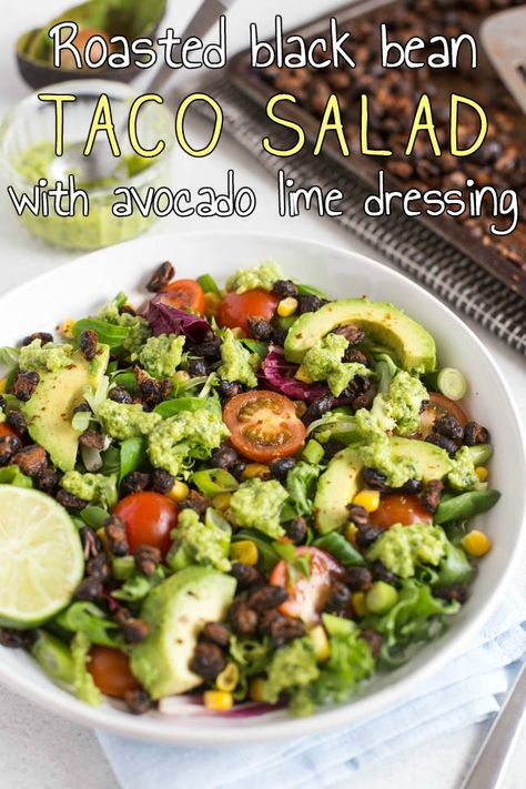Roasted black bean taco salad with avocado lime dressing - a healthy, vegetarian / vegan Mexican inspired recipe! The spicy roasted black beans add such a fantastic crunch!
