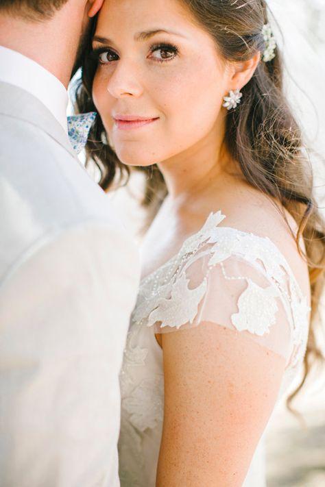 lace cap sleeves, photo by Josh Elliott Studios http://ruffledblog.com/hilltop-malibu-wedding #weddingdress #bride