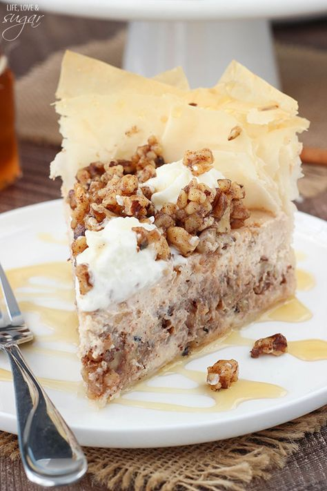 This Baklava Cheesecake is such a fun twist on the traditional Greek dessert. With all the flavors of cinnamon, honey and walnuts, it's a fun way to mix together two delicious desserts into one!