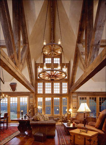 Western Homestead Ranch Living room showing wall of windows over the lake design idea Lynne Barton Bier designer