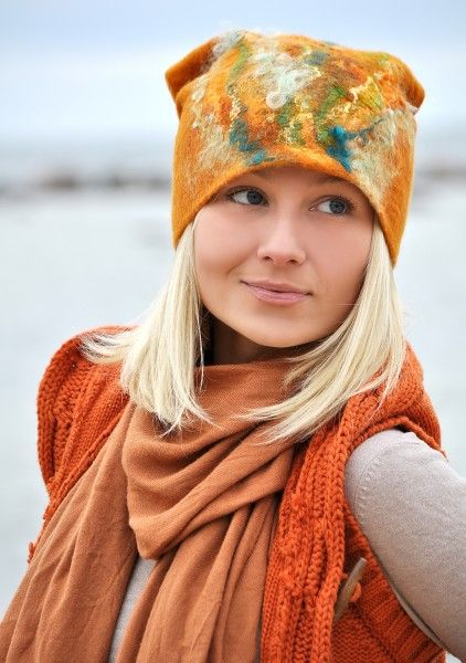 felt hat with chunky/textured knit and larger scarf.