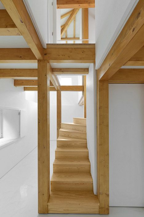 Wooden trusses support new mezzanines inside this remodelled stone building.