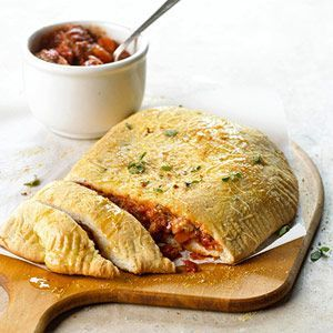 Smoky Calzones                             The smoky flavor of this Italian main dish recipe comes from the smoked Gouda cheese. Don't forget to pass the beef Bolognese sauce for dipping.