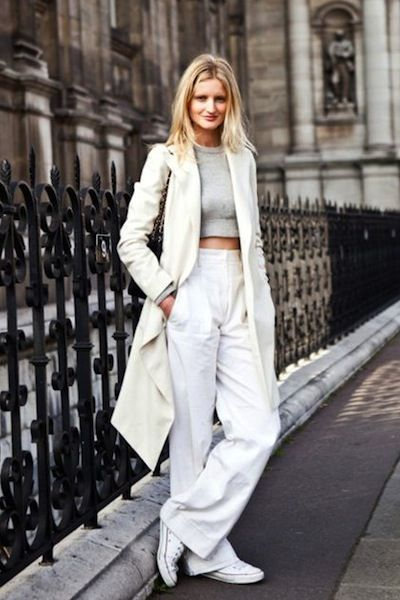 All white-long coat, crop top, loose pants, and converse sneakers.