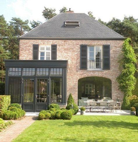 Renovation project by Vlassak Verhulst, love the conservatory