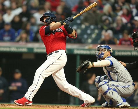 Cleveland Indians Kevin Plawecki watches his home run hit off Toronto Blue Jays starting pitcher Trent Thornton with Toronto Blue Jays catcher Luke Maile behind the plate in the third inning, April 5, 2019, at Progressive Field. (John Kuntz cleveland.com). Indians won 3-2.