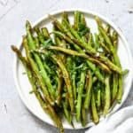 You will love these tasty and healthy air fryer green beans that are ready in less than 10 minutes! Get the step by step recipe for air fried green beans. #airfryer #airfryerrecipes #airfryergreenbeans #greenbeans #airfried #airfryervegetables #greenbeansrecipe #veganrecipes #healthyairfryerrecipes #airfryerrecipeshealthy #veganairfryerrecipes