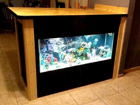 Built this custom bar to fit like a glove around this 55 gallon aquarium..Top panel lifts up to feed the fish and the bottom panel under the tank opens and it is all storage underneath..