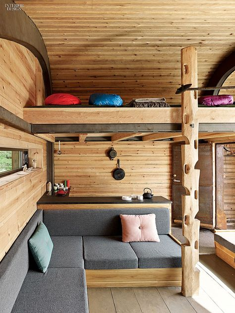 Earth, Water, Air, Fire: Handcrafted Cabin by Snøhetta Celebrates Norway | For access to the sleeping loft, a log was hand-carved to create footholds. #design #interiordesign #interiordesignmagazine #wood #architecture #decor @snohetta
