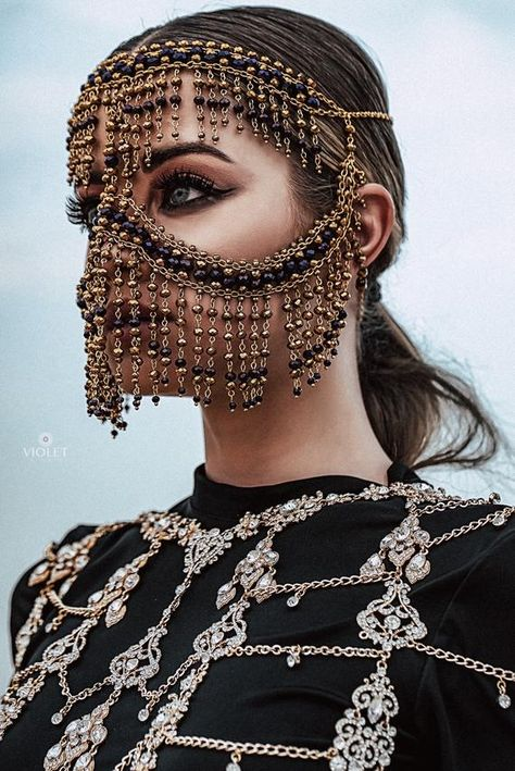 Stylish mask in Arabic style will be perfect for parties, for bellydancer performances and concerts. Golden and violet beads combination. Fastened at the back of the head with 2 lobster clasps - the size is adjustable with an extension chain. Easy and comfortable to wear.