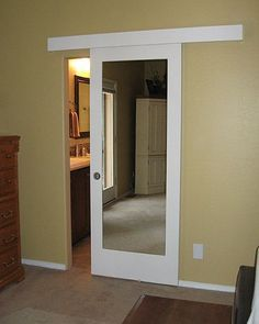 small bathroom door solution barn door track and hardware mirror in a primed door