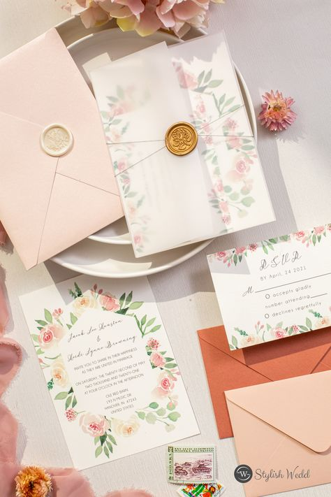 This blush pink wedding invitation brings to mind soft florals, joy, and love – all things you're hoping for on your big day. #wedding#weddinginvitations#stylishwedd#stylishweddinvitations #vellumweddinginvitations#weddingideas