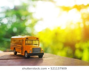 Yellow School Bus Plastic And Metal Toy Model On The Natural