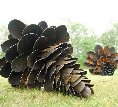 Giant pine cones from old shovels. I just love this yard art
