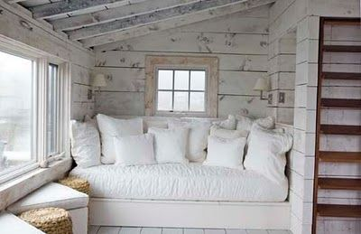 Daybed overflows with soft pillows. The wonderful sconces provide just the right light for curling up with a good book.