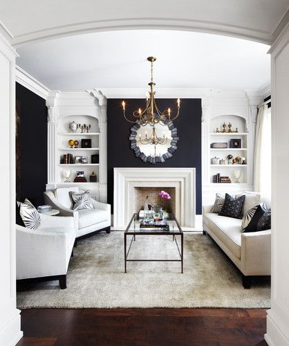 White fireplace against black wall