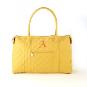 """City Tote - Daffodil  20""""W x 12.5""""H x 9""""D  No matter where you travel, our City Tote is a perfect fit! Large, open interior has a zipper pocket and lots of room! Double handles with an 8.5"""" drop make for a secure shoulder carry. Two exterior zipper pockets for keeping items close at hand. Top zipper closure with dual zipper pulls. Available in 8 mouth-watering colors. Black, Chocolate, Pewter, Berry, Koi, Daffodil, Scarlet, and Green Tea in Quilted Pebbled Faux Suede. $69. www.myinitials-inc.com/jgorgei"""
