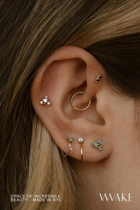 The Diamond Burst Earrings, The Mini Two-Step Hoop, The Opal Dot Hoop, The Tri-Opal Earring, The Small Opal Stud, The Opal Cloudburst Earring, The Two-Step Chain Earring