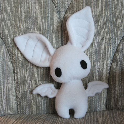 Plush bat, designed and sewn by me 16 in tall x in wide Made with white fleece --- Poor Dexter was born a little oddly proportioned, with big, big ears and wings too tiny for flying. Sewing Stuffed Animals, Cute Stuffed Animals, Stuffed Animal Patterns, Felt Crafts, Diy And Crafts, Arts And Crafts, Softies, Plushies, Sewing Crafts