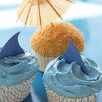 ocean cupcakes - tint frosting blue, add shark fin from card stock or foam; sand look from finely ground graham crackers- add small umbrella ~ http://www.dealiciousmom.com/shark-beach-cupcakes/#utm_source=crowdignite.com_medium=referral_campaign=crowdignite.com