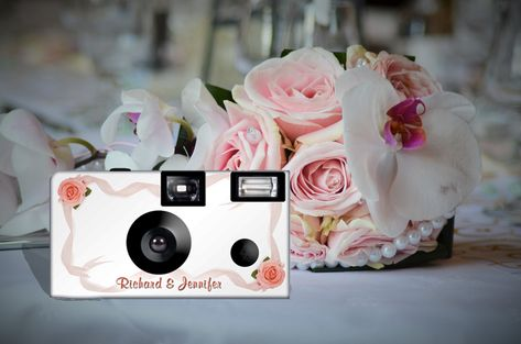 Add this beautiful camera to your reception tables and let guest capture your special day. 'Roses and Ribbons' disposable camera can be PERSONALIZED. Listing is for 10 cameras and 10 tent cards. 24 exposure, Fuji high speed 35mm color film, disposable camera.   #camera #weddingcamera #disposablecamera #roses #ribbon #pinkribbon #single use #35mm #film #weddingfavor #pictures #personalized #Etsy