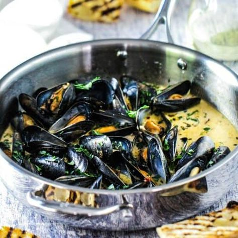 Mussels with Garlic and Wine is about as delicious and comforting a dish that you will ever have or make. The sauce is perfect for perfectly toasted bread.