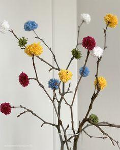 Photo of Die Zweige bekommen bunte Blüten – mit Pompoms aus Wolle