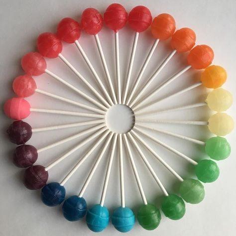 Brightly Hued Candies and Other Objects Arranged by Color to Create Visually Pleasing Designs