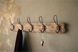 """Our Recycled Wood Coat Rack with Vintage Wire Hooks is perfect for farmhouse living. The rustic character of the recycled wood makes each piece unique. The vintage style wire hooks are inspired by antique hooks found in old schoolhouse coat rooms. Whether your style is country farmhouse or vintage industrial, this coat rack's simple design will be at home in any mudroom, kitchen or bedroom. 26""""W x 5.5""""H"""