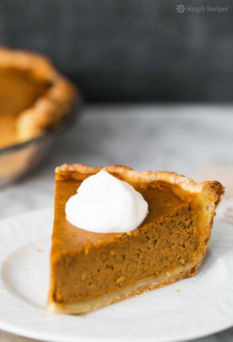BEST homemade pumpkin pie recipe! With fresh or canned pumpkin purée, cream, brown and white sugar, eggs, and pumpkin spice. Favorite pie for Thanksgiving! On SimplyRecipes.com