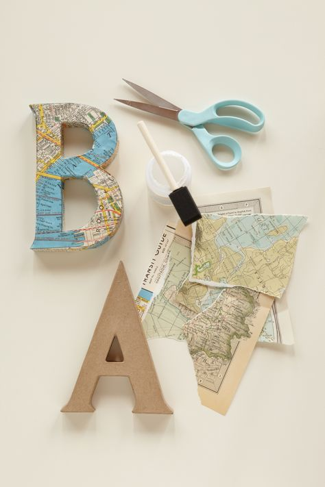 """map covered letters for travel theme decor - JOURNEY OF LOVE, Decoupage Letters. Use vintage maps and cut out letters to spell out """"baby"""" or the baby's name for the backdrop to your baby shower. Decoupage Letters, Cardboard Letters, Painting Letters, Craft Letters, Lila Party, Travel Baby Showers, Map Crafts, Travel Crafts, Travel Nursery"""