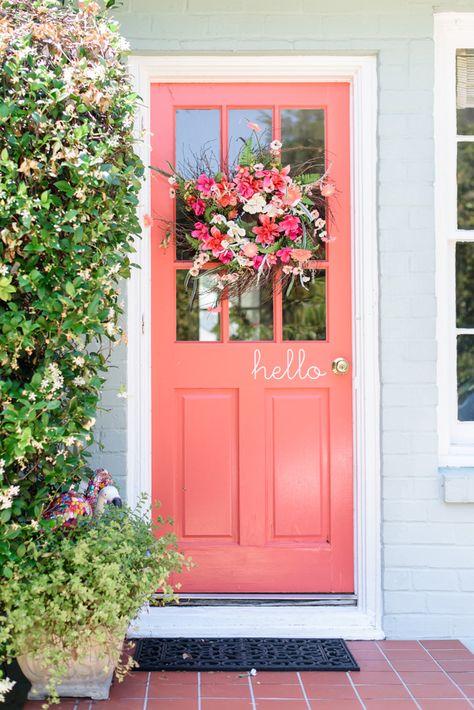 Coral front door | Sarah & Ben http://southernweddings.com/2016/07/26/florida-citrus-wedding-by-sarah-and-ben/